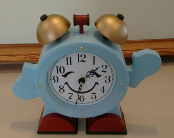 Un-alarming Clock: This is another whimsical clock that would be a very nice addition to your child's bedroom.