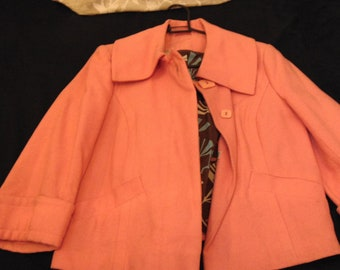 Coat Peachy Pink with flower pattern inside size 10