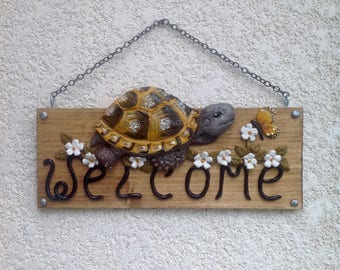 Turtle Tortoise testudo hermanni welcome sign
