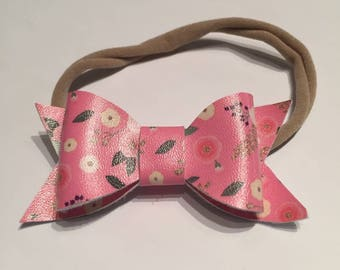 Pink floral faux leather bow on nylon headband