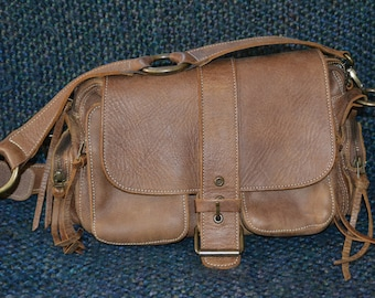 ROOTS HANDBAGB ,Bag, Vintage weathered handgrained LEATHER. Handcrafted in Canada, Italian Craftsmanship, Fringe pulls, 2 Front ext. pockets