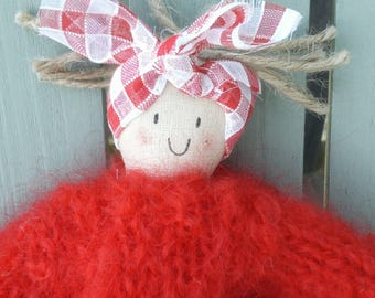A handmade doll with a vintage voille gingham skirt