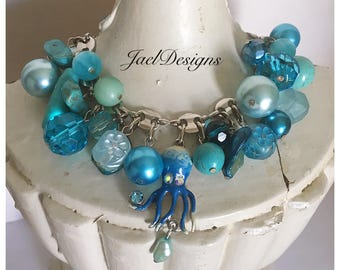 Turquoise Blue Vintage Bead and Charm Bracelet - Silver Chain - Octopus