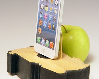 Docking station charger for ANY iPhone. Very cool.  Free form design. One of a kind.  303. Reclaimed wood. Edgy. Contemporary.