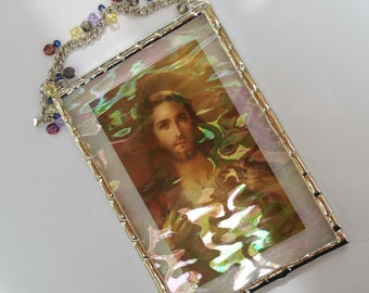 Sacred Heart of Jesus plaque with a Swarovski crystal and freshwater pearl hanger under iridescent water glass