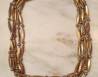 Vintage Hong Kong multistrand gold tone necklace