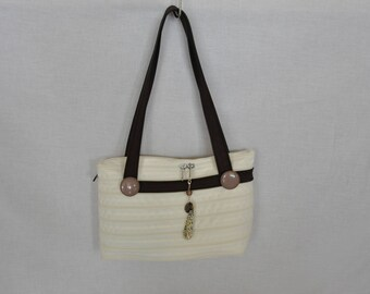 Fully zippered bag.