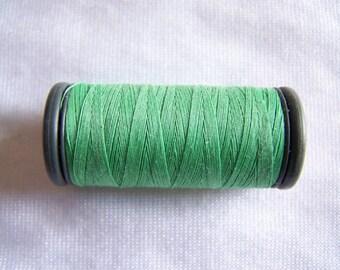 Spool of fils à coudre DMC special machine, pistachio green (4707)