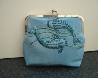 Silk Clutch Bag with Embroidered Fish Design.