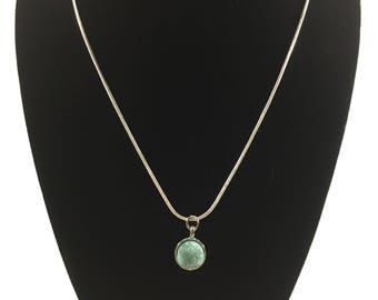 Silver necklace with turquoise colored  blue stone pendant