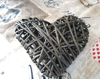 Heart pendant made entirely of newsprint
