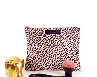 Pink with black spots leather clutch bag