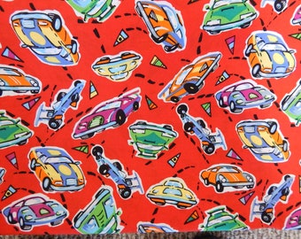 """Race Car Fabric, 100% Cotton, 45"""" wide, features race cars on a red background"""