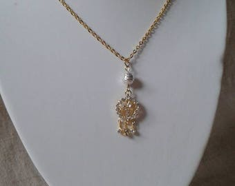 Gold and white oriental style necklace