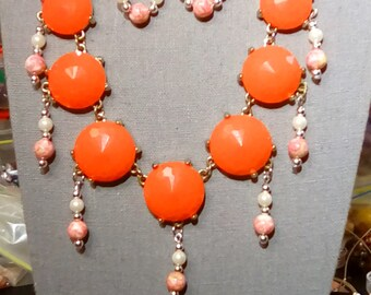 Light orange cabochon necklace with multi color bead and faux pearl accents