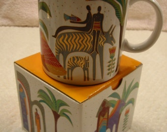 "vintage 'Laurel Burch' mug . . .""Morning at the Oasis"". . . very collectible . . . dated 1989 . . .  new in original box . . . made in Japan"