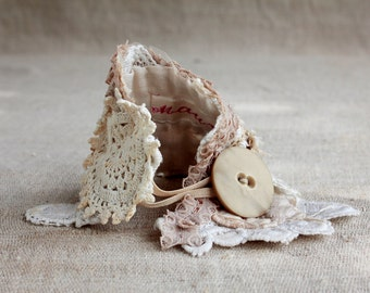 Extra Romantic Bridal Cuff of various vintage laces (including Dipiur lace) Decorated with lace & crochet delicate flowers