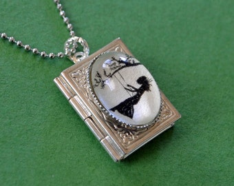 GIRL on a SWING Book Locket Necklace, pendant on chain - Silhouette Jewelry