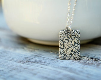 Embossed Roses Tag Necklace in Sterling Silver