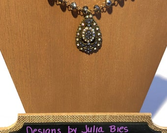 Iridescent purple-brown Swarovski style beaded necklace with an opalescent rhinestone accented teardrop pendant