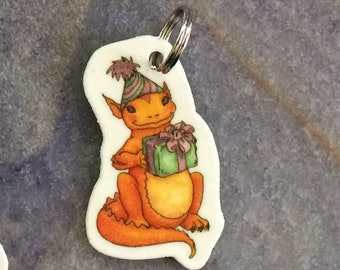Gold's Gift (a dragon and a present) art charm for backpack, phone, necklace, keychain, zippers...