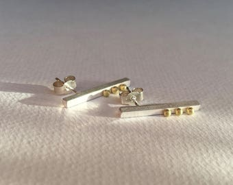 Silver bar earrings with 18 carat gold decoration