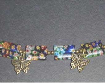 Millefiori bracelet with antiqued brass butterfly charms.