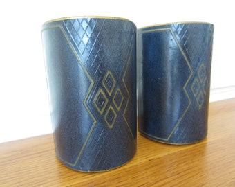 Art deco style bookends.  Vintage blue leather bound bookends.  Circa 1930s vintage book ends.