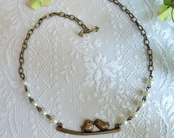 Vintage Style Antique Bronze Pearl Necklace with Two Birds on a Branch Pendant. Cute Best Friends Necklace; 17 inches with toggle closure.