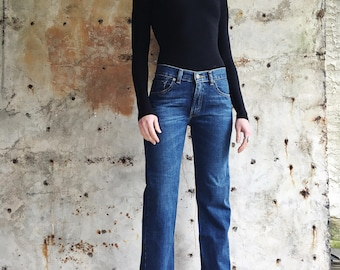 The Tomboy 1980s Dark Wash Levis 505 Red Tab Slim Cut Cropped Jeans 24