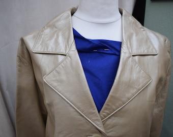 Brand new womens leather jacket. 100% genuine leather gold jacket