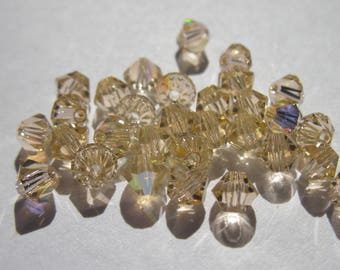 30 genuine swarovski crystal bicones 4mm - light peach AB-(12)