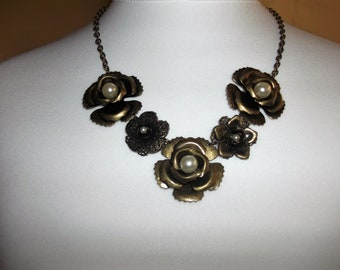 Vintage bronze tone necklace floral effect flowers with pearl centres .