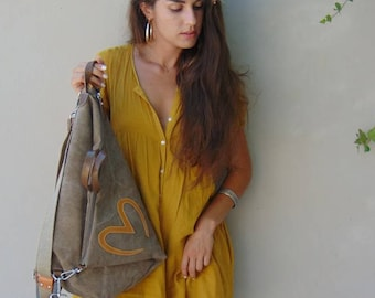 Handmade convertible ,backpack,shoulder ,cross body bag ,in canvas-leather,named CUORE
