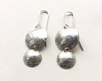 Simple, hammered silver earring