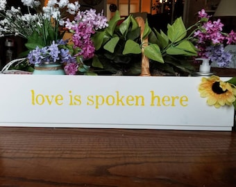 Love Is Spoken Here wood sign