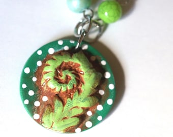 Green Fiddlehead polymer clay pendant round necklace original art by Cortney Rector Designs