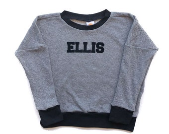 Collegiate Name Sweatshirt. Customize it! A personalized sweatshirt with your child's name professionally applied to front.