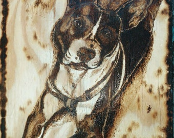 Pet portraits drawn and burned by hand
