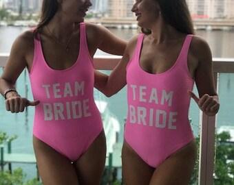 Team Bride Swim Suit, Brides Squad Bathing suit, Squad Swimwear, Bridesmaid Gift, Onesie Swim Suit. Bachelorette Swim Suit, Team Bride
