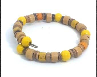 A yellow and orange tones row style bracelet child model memory Bohemian