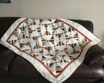 Red, blue, yellow pinwheel quilt