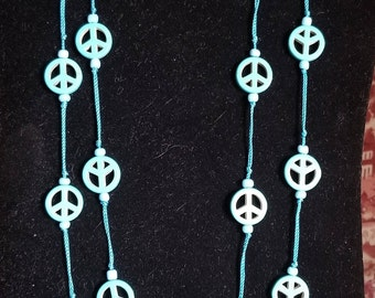 Silk thread necklace with turquoise Natural stone in 2-stranded peace symbol