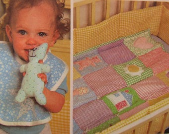 Vintage 1980 McCall's pattern #7268 includes 55 pieces for one size baby items - Quilt, Crib Bumper, Bag, Bib, Mobile, Toys