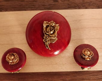Plastic brooch and clip on earrings with metal rose embellishment