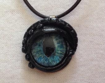 Small Round Glass Dragon Eye Pendant.