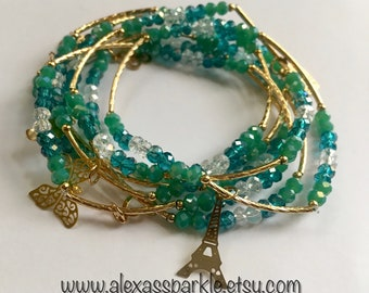 Teal transcendent beaded bracelets with gold plated charms - Semanario verde azulado transendente con dijes de chapa de oro