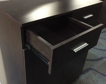 Shoe cabinet made for large shoe sizes. With 2 storage draws for keys and mail.