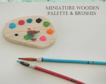 Miniature wooden paint palette and 2 wooden paint brushes.
