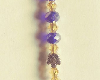 Blue and gold zipper pull with a dolphin charm